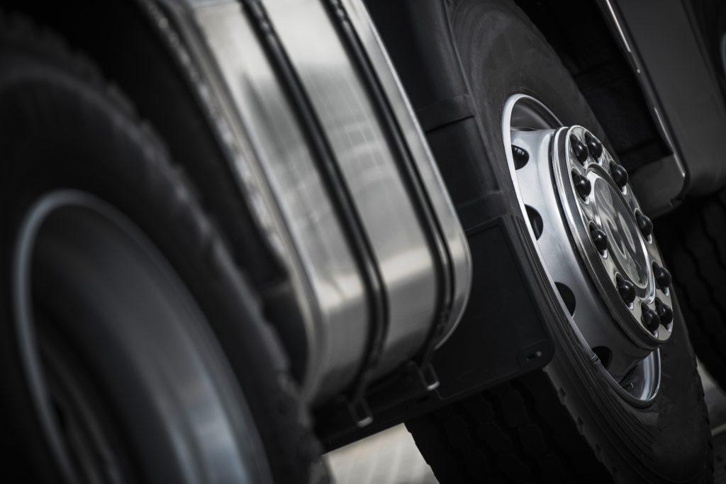 Heavy Duty Semi Truck Wheels Closeup Photo. Commercial Transportation.